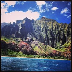 Hike the green folded cliffs and secret beaches of the 11-mile Kalalau Trail on the island of Kauai.