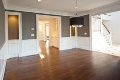 """Benjamin Moore """"steel wool, """" white wainscoting and a darker wood floor, should hopefully be how our living/dining room will turn out!"""