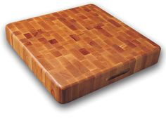 Whether you're a professional chef or a home cook, this reversible wood cutting board will make a handy addition to your kitchen. Made of end-grain domestic hardwood, this cutting board is durable, spacious and designed not to dull your knives.