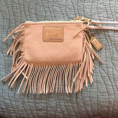 Brand new never worn Coach Wristlet! HOST PICK ✨ This fringe beauty is just what your closet needs!!! Look fab with this on your wrist. Brand new never worn Coach Bags Clutches & Wristlets