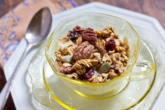 Pumpkin Maple Granola Recipe Breakfast and Brunch with pumpkin purée, maple syrup, egg whites, cinnamon, nutmeg, ginger, clove, salt, oats, pecans, coconut, pepitas, seeds, dried cherry