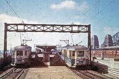 Sydney Trams travelling in each direction on the Sydney Harbour Bridge, Sydney, Australia. v@e.