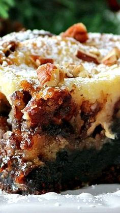 Brownie Pecan Pie Ooey Gooey Butter Cake ~ A fudge brownie layer, topped with a pecan pie filling and then a cheesecake layer. Ooey gooey cake at it's best! also links to other gooey butter cakes. Köstliche Desserts, Delicious Desserts, Yummy Food, Health Desserts, Sweet Recipes, Cake Recipes, Dessert Recipes, Picnic Recipes, Brownie Recipes