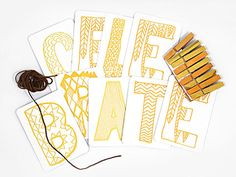 "Decorating for parties is a snap with this easy-to-assemble banner set that spells out ""celebrate"" in letterpressed cards. Also included: fun colored clothespins and vintage string for hanging."