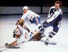 Canadiens goalie Ken Dryden and teammate Brian Engblom defend the net against the Maple Leafs' Walt McKechnie during a game in 1978-79 at th...