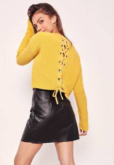 Pop some bold colour into your knit game and feast your eyes on this chartreuse green jumper in a boxy style and a sexy lace up back.