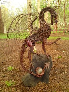 Wow someone is incredibly artistic to create this! I want it, but the lovable demon dogs would just stalk & eat it. DRAGON, or other mythical recycled creations for the garden.