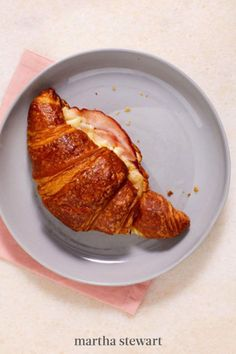 Make a twice-baked Hot Ham-and-Cheese Croissant. It sounds fancy, but it's actually quite simple: Cut a couple of slices of ham and insert them into a pocket you cut in a croissant, then add Swiss and Gruyère cheese, a little mustard and mayo, and bake until the cheese melts. It's a truly delicious way to start the day. #marthastewart #recipes #recipeideas #easterfood #easterrecipes #eastertreats #easterideas Ham And Cheese Croissant, Gruyere Cheese, Leftover Ham, Melted Cheese, Easter Treats, Easter Recipes, Creative Food, Mustard, Pork