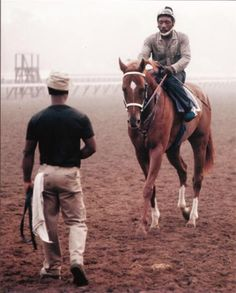 Secretariat and exercise rider Charlie Davis, Charlie loved that horse like no tomorrow.