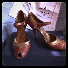 Prada Heels Stunning brown and beaded copper/gold peep toe heels. EUC with original box and two dust bags. Sole protectors have kept the leather soles in near perfect condition. Prada Shoes Heels