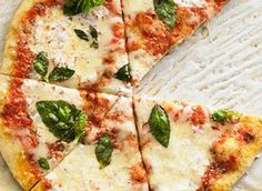 Margarita pizza for one. Roll out your dough and add jarred tomato sauce, halved cherry tomatoes, shredded and sliced mozzarella cheese, a handful of chopped basil and a 1/2 tsp of red pepper flakes. Now you can call yourself an Italian!