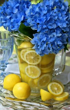 A Little Loveliness - pretty yellow lemons combined with bright blue hydrangea flowers to make an awesome centerpiece. - Home Decor Pin Summer Table Decorations, Decoration Table, Summer Centerpieces, Centrepieces, Blue Hydrangea Centerpieces, Table Centerpieces, Mellow Yellow, Blue Yellow, Periwinkle Blue
