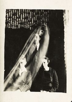 Woman with two boys and a female spirit; The spirit photographs of William Hope (from around 1920);  From the collection of the National Media Museum