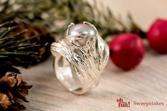 This perfect pearl ring is sure to add a unique flare to your expressive holiday style. || Gray Cultured Freshwater Pearl Center Sterling Silver Nest Ring [Promotional Pin]