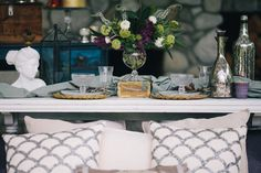 Vintage white coffee table from Vintage Ambiance (hard to see with the gorgeous table setting for two) but it's stunning! | Photography: Ivy & Tweed Photography - ivyandtweed.com  Read More: http://www.stylemepretty.com/2014/09/17/the-hamptons-meets-west-coast-wedding-inspiration/