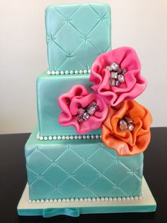 Custom Wedding Cake if Tiffany Blue with pops of color of hot pink and orange www.gimmesomesugarLV.com