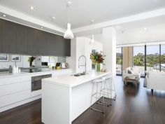 EXAMPLE KITCHEN / LIVING ROOM (charcoal grey / white / mirror splashbacks) 13/264-270 Lawrence Hargrave Drive, Thirroul, NSW 2515