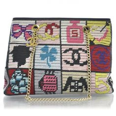 This is an authentic CHANEL Needlepoint Precious Symbols Shoulder Bag.   This charming shoulder bag is crafted of bright needlepointed squares of classic Chanel symbols.