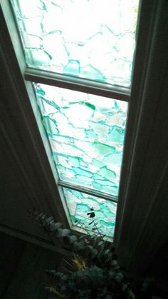 "Seaglass using ""Lexel"" adhesive on glass panels by front door."