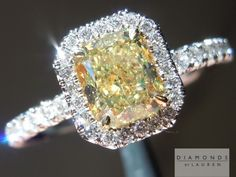 This hand forged diamond halo ring is a perfect setting for this gorgeous Fancy Yellow radiant cut diamond.