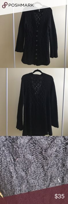 """Free People cardigan Black swing style long tunic sweater with decorative buttons and generous sleeves. Cable so it down center in front and back. No stains or snags, but has some pilling from wear. From shoulder to bottom is approximately 35"""" Free People Sweaters"""