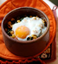 Kale, chickpeas, and sausage with oven baked egg.
