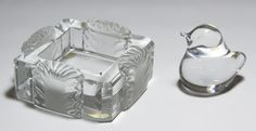 """Lot 475: Lalique """"Corfu"""" Ashtray; Having shell motif on the sides and the Lalique mark on the underside; together with a """"Daum France"""" marked bird"""