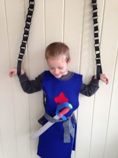 Boys' medeival knight birthday party decorations and gifts: sword, handmade felt tunic, and paper chain prison 2nd Birthday Parties, 7th Birthday, Birthday Party Decorations, Party Themes, Party Ideas, Birthday Ideas, Birthday Activities, Party Activities, Medieval Party