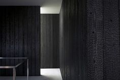 Eel shop designed by Toru Shimokawa. Walls of charred cedar wood. Fire-resistant.