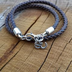 Check out this item in my Etsy shop https://www.etsy.com/uk/listing/246302468/leather-bracelets-leather-om-charm