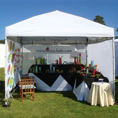 Streamlined booth display! Cute way to drape table.