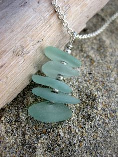 Aqua Beach glass found on a secret south shore beach on Oahu, Hawaii, drilled through the center and stacked on top of each other on silver plated materials and separated by silver plated beads.  handmade by myself in kailua, oahu, hawaii