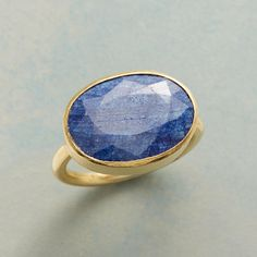 BLUE BRUSHMARK RING--A sizable sapphire tinted beguiling blue, surrounded by our ring's brushed setting of 22kt gold plated sterling silver. Handcrafted exclusively for Sundance. Whole sizes 5 to 9.