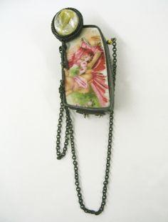 Carolina Hornauer  Brooch: Ceramic 2007  Silver, gold bead, found ceramic piece, silver chain, citrine quartz, patina, steel wire  3 x 1,5 cm