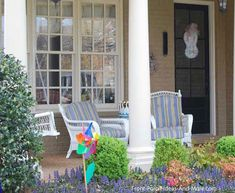 Porch Decorating Idea: The colorful striped wicker furniture coordinates with the flowers planted near this front porch! See more: http://www.front-porch-ideas-and-more.com/franklin-tennessee.html