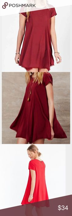 UO Silence + Noise Witchy t-shirt dress Flowy and soft dress from Urban Outfitters/Silence + Noise in maroon. Super comfy and lightweight! Quarter zip in the back. Only worn a handful of times, it's in great condition. silence + noise Dresses