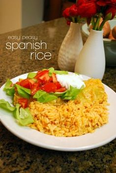 Easy Spanish Rice. Will go perfect with Chicken Tacos and Refried beans I'm making for dinner tonight