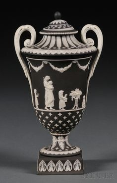 Wedgwood Black Jasper Dip Diceware Vase and Cover, England, 19th century, applied white relief figures from Domestic Employement bordered with quatrefoils.