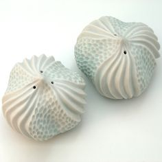 Carved porcelain salt shaker set, sea urchin in white & aqua blue.   by Roberta Polfus
