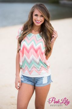 Short sleeve white top with peach, coral, mint, light taupe, and grey chevron print and does not have lining or padding underneath!
