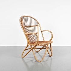 Rattan Armchair, circa 1960 | From a unique collection of antique and modern armchairs at https://www.1stdibs.com/furniture/seating/armchairs/