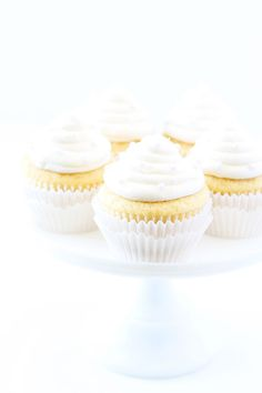 Vanilla Almond Cupcake Recipe on twopeasandtheirpod.com Tender and moist vanilla almond cupcakes with creamy vanilla almond buttercream frosting. These elegant cupcakes are perfect for weddings, showers, or parties!