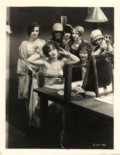 Clara Bow, seated left, in Rough House Rosie