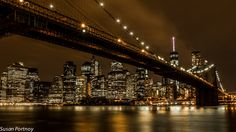 Underneath the Brooklyn bridge looking towards Manhattan and the World Trade Center building