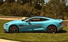 Aston-Martin-Vanquish-Left-Side-Blue Photo on August 21, 2012