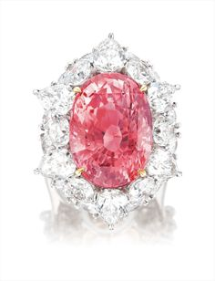 An Exceptional and Rare Padparadscha Sapphire and Diamond Ring. One oval padparadscha sapphire, carats. Pear-shaped and brilliant-cut diamonds in the surround, totalling carats. Platinum and 14 karat white gold. Sapphire Jewelry, Gemstone Jewelry, Pink Sapphire Ring, Orange Sapphire, Pear Shaped Diamond, Halo Diamond, Saphir Rose, High Jewelry, Art Design