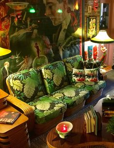 This retro tiki inspired room is so cool, look at that mural. All the prints and colors are alot to handle, I love this...