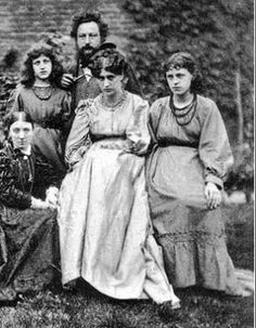 William Morris with May on his left, Jane sitting center and Jenny Morris to the right. In the corner peeking out is Lady Burne-Jones