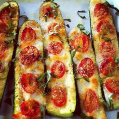 Low Carbs  Slice the zucchini in half.  Slice off the bottom to keep in stable.  Brush with olive oil & top with garlic or garlic powder.  Top with sliced tomatoes, salt & pepper for taste.  Use Mozzarella or Parmesan cheese, or mix cheeses.  Bake 375 for 20-30 mins until soft.