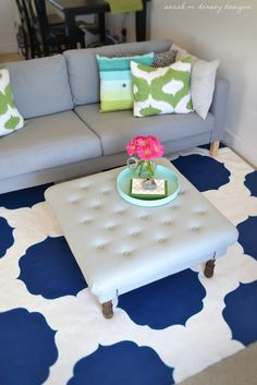 Blue and white painted rug Floored By Design: 11 DIY Rug Projects